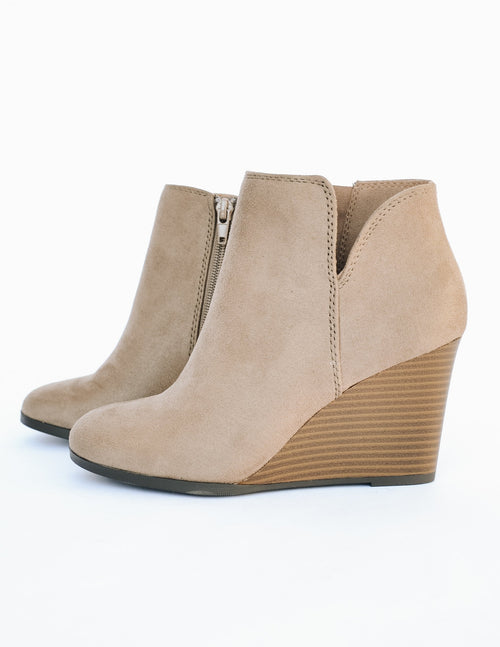 Taupe risk taker heel with faux wood stacked wedge heel on white backbround