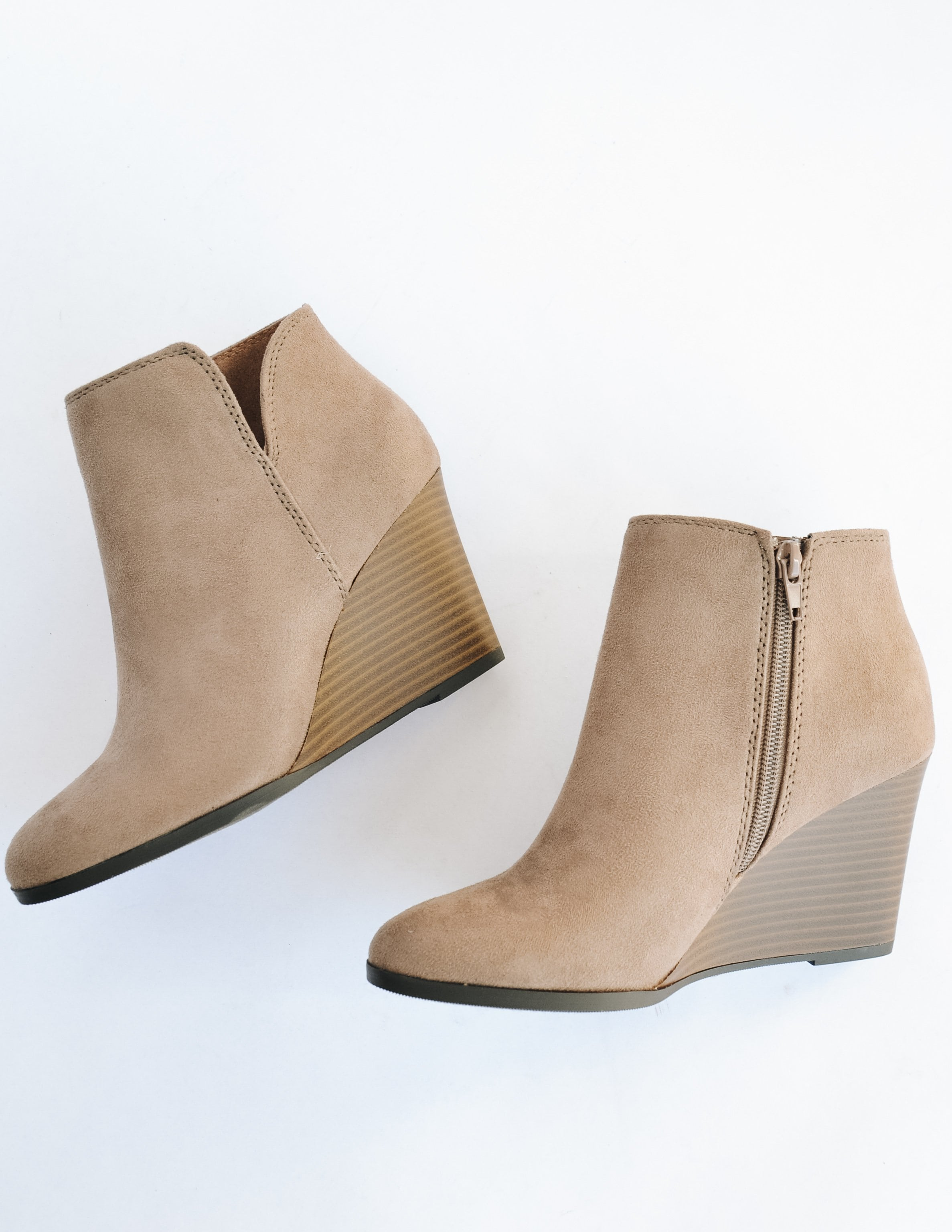 Taupe risk taker heel laying flat on white background showing inner zipper