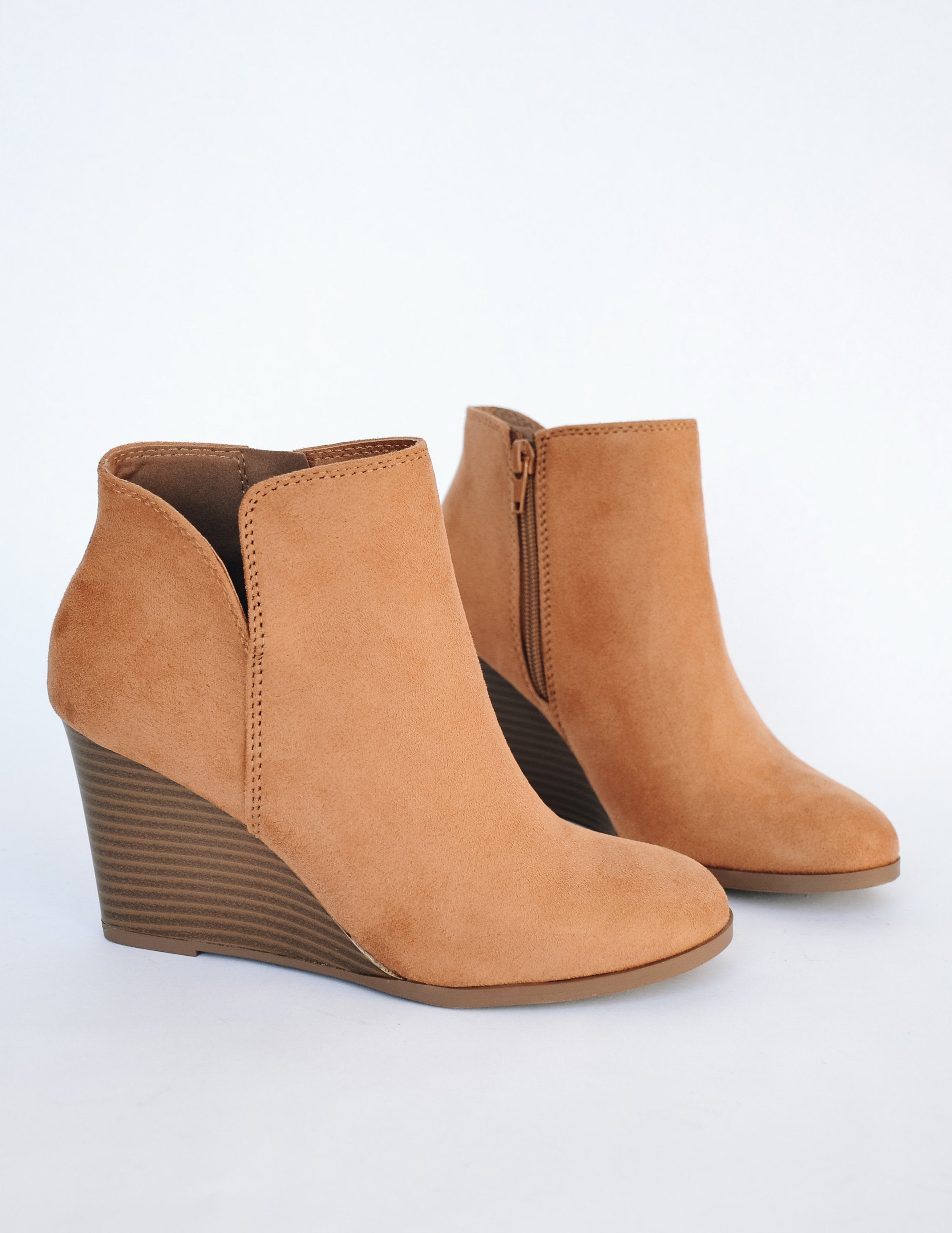 Faux suede risk taker wedge heel with small v cut on side and inner zipper