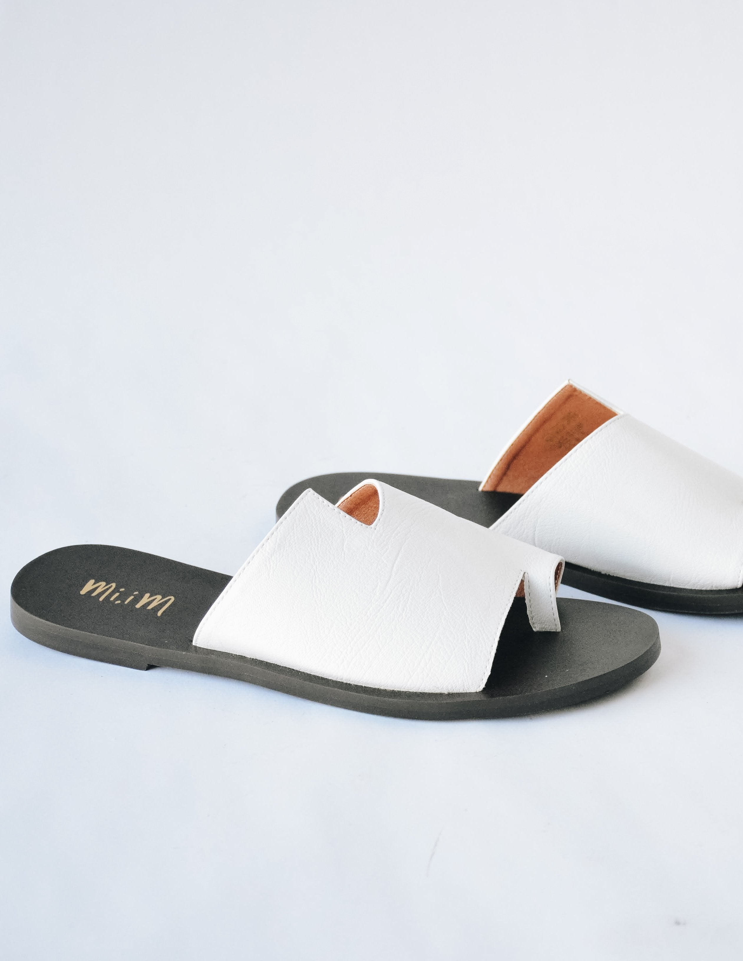 White addison sandal with black sole