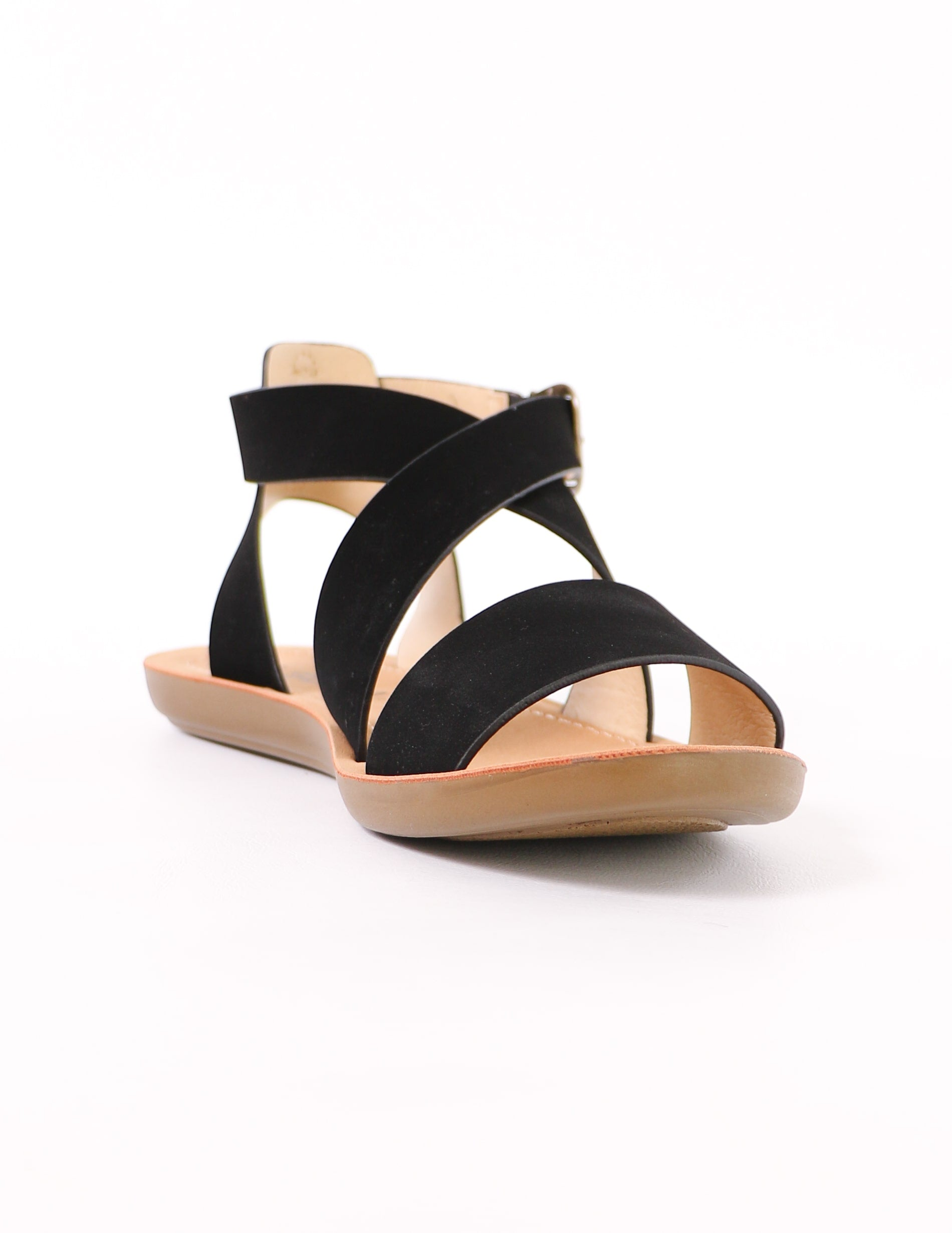 tan sole and black upper on the criss cross my heart sandal