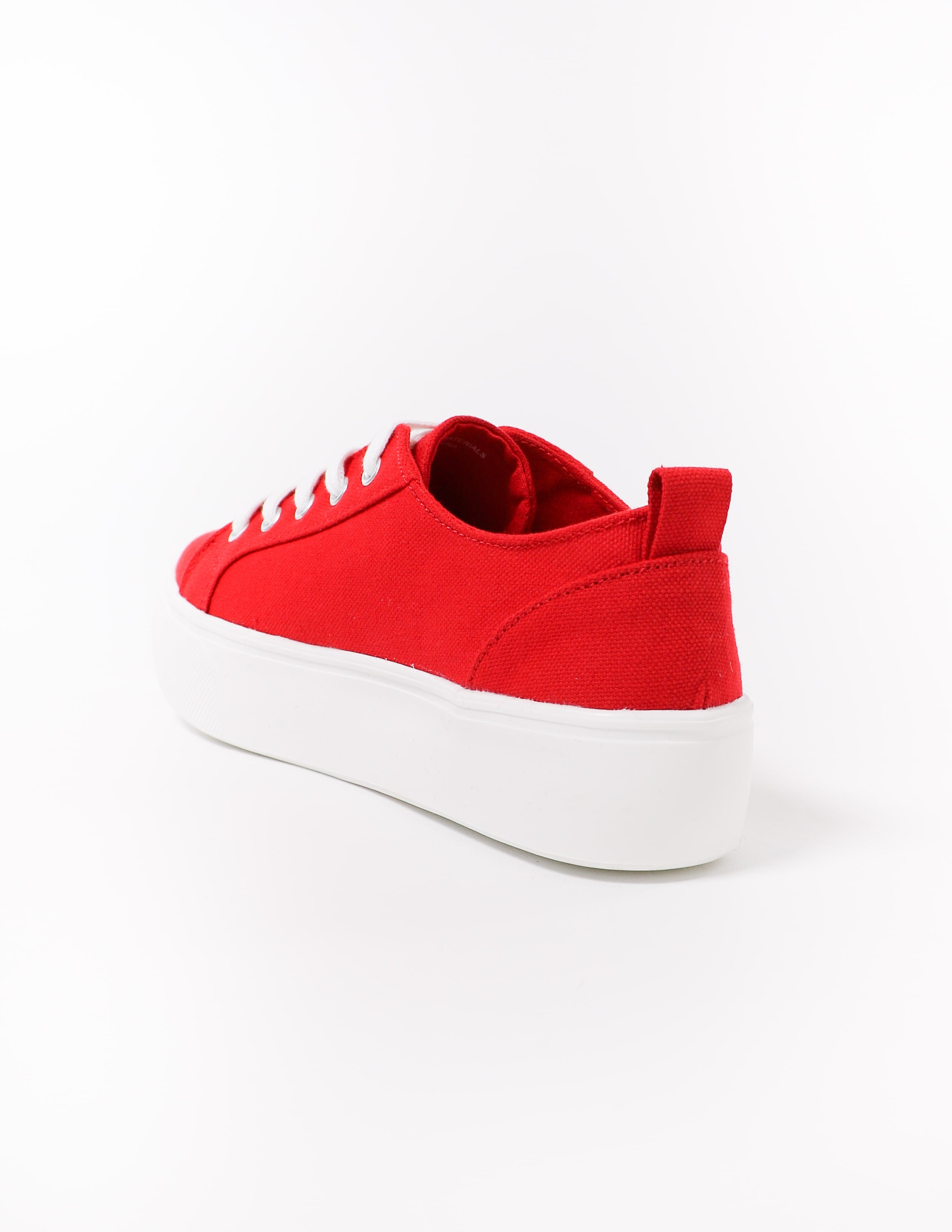 back of the red lace take it slow sneaker on white background