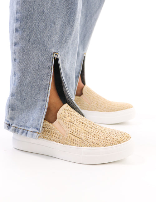 model standing in raffia natural sole call platform sneaker