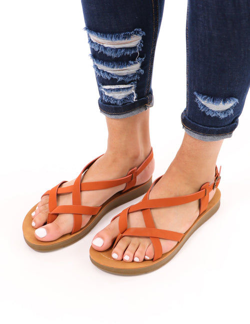 rust watch it soda criss cross sandal on model wearing distressed denim - elle bleu shoes