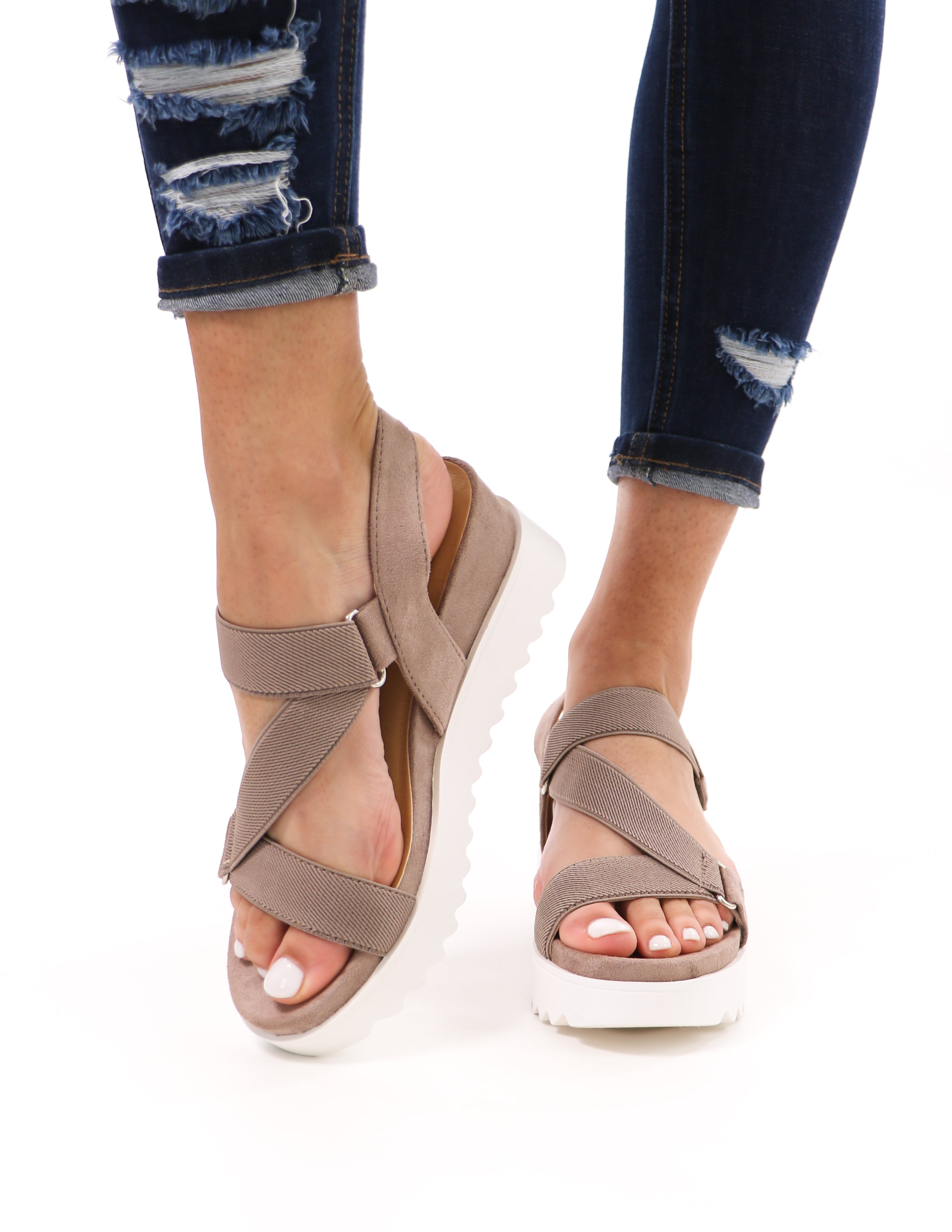 strappy go lucky sandals with white chunky rubber sole and taupe straps and insole on model - elle bleu shoes