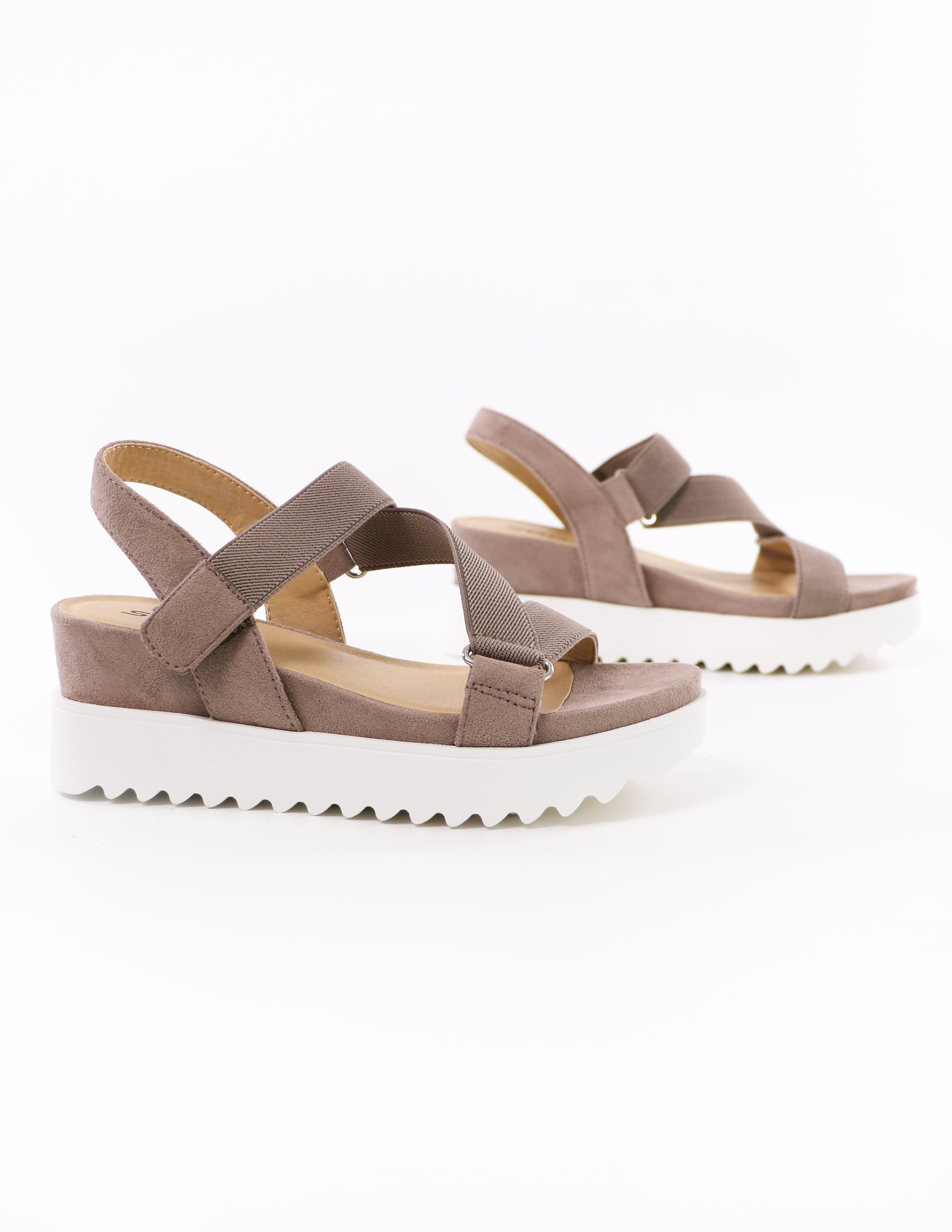 close up of the taupe strappy go lucky sandals on white background - elle bleu shoes