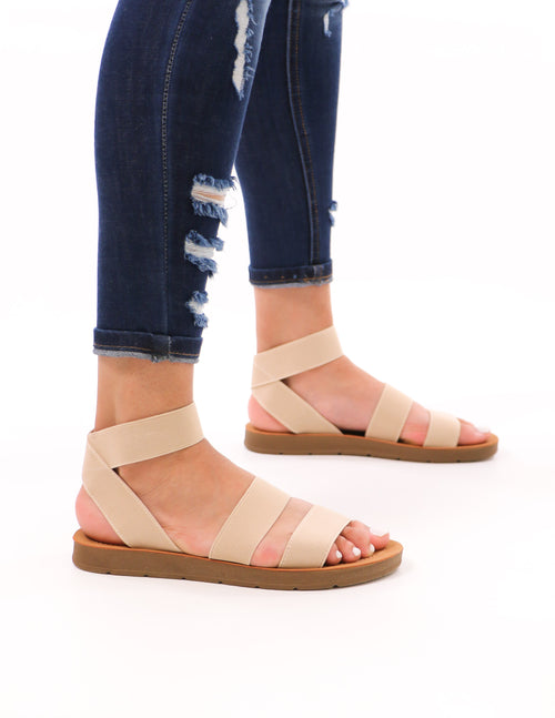 model standing in natural elastic cabana sandal and denim