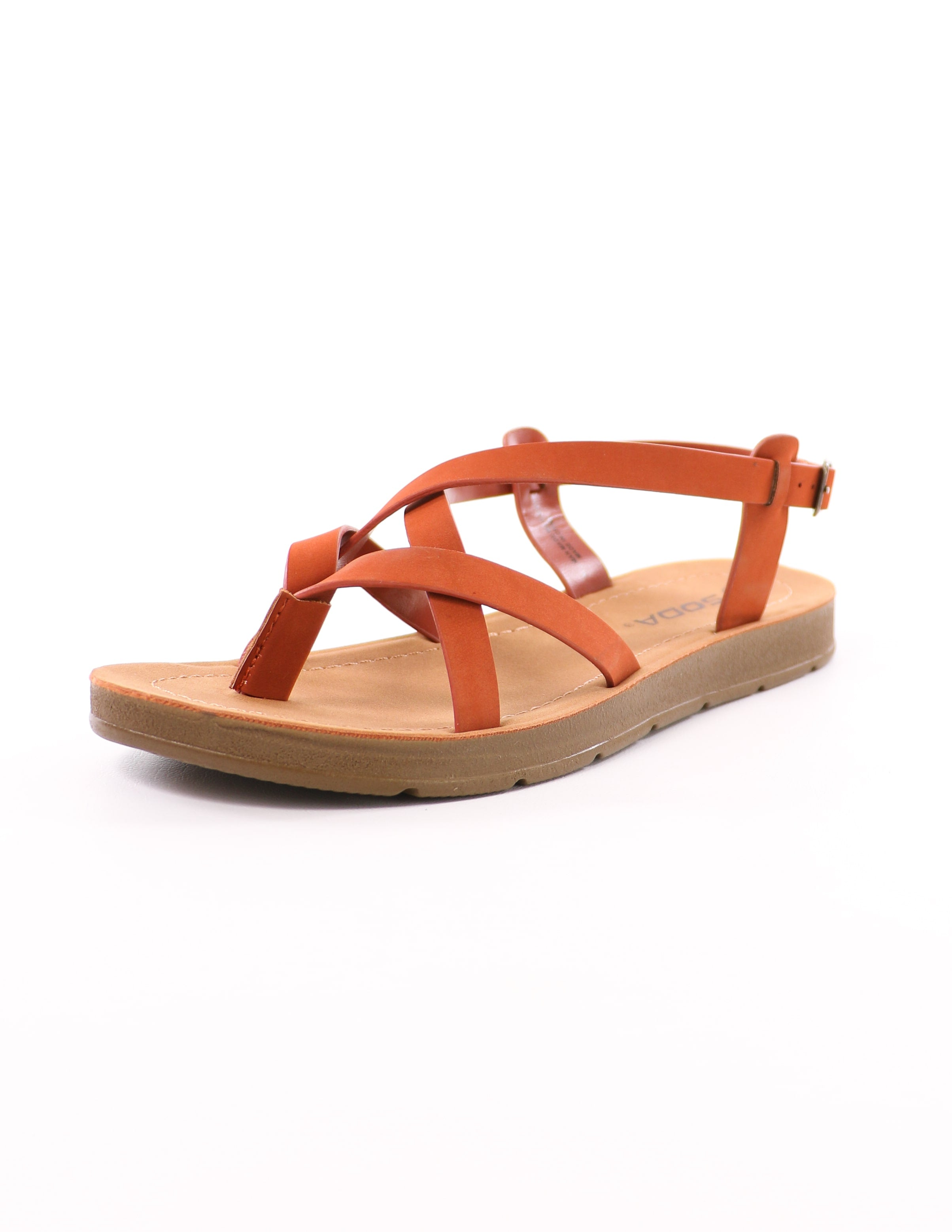 front of the rust watch it sandal with tan rubber sole and criss cross thin straps - elle bleu shoes