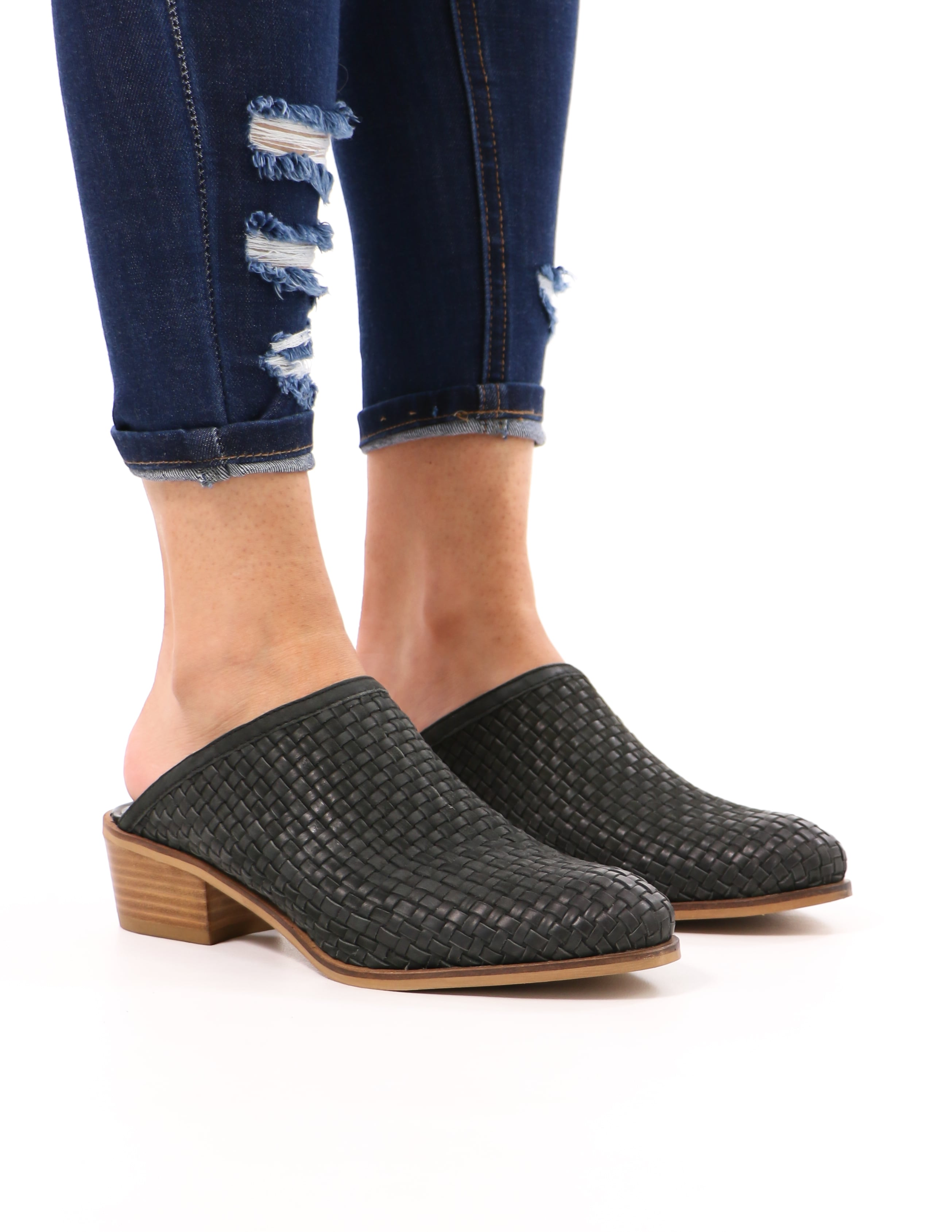 model standing in black the woven one mule with almond toe - elle bleu shoes