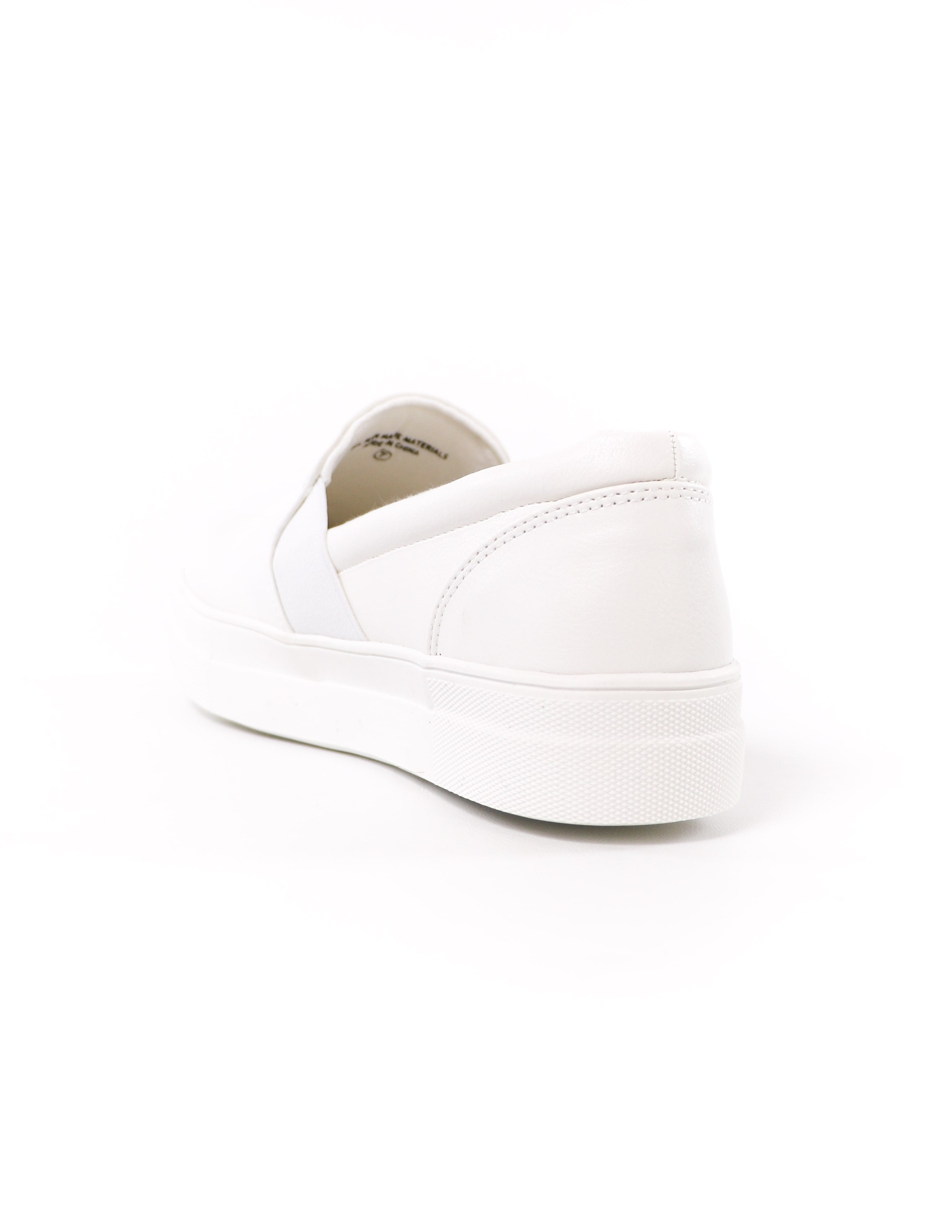 back of the white kickin' it sole-o slip on sneaker on white background - elle bleu shoes