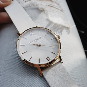 Gold/White Timepiece