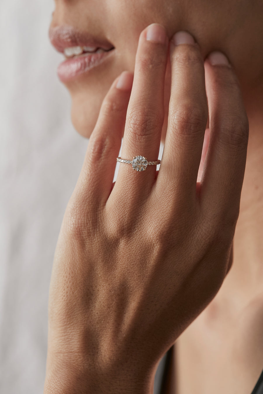 ROUND DIAMOND ENGAGEMENT RING WITH PAVE BAND