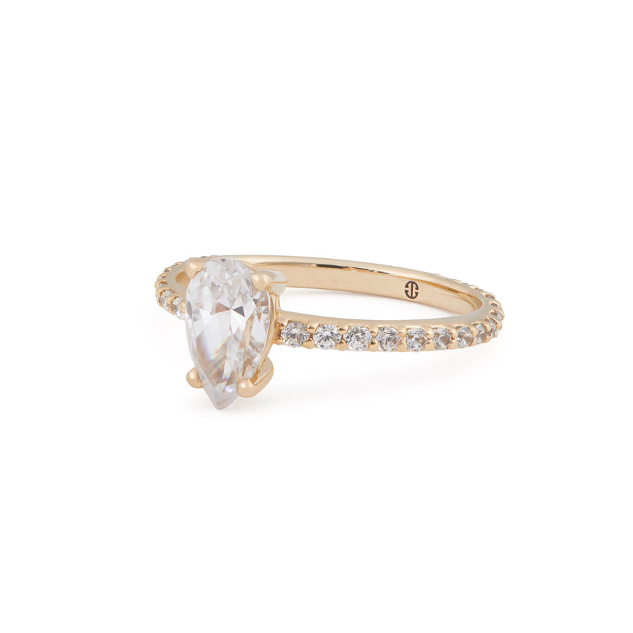 PEAR DIAMOND ENGAGEMENT RING WITH PAVE BAND