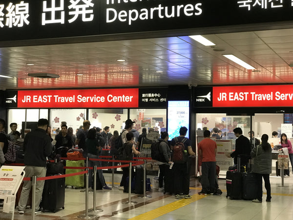 90-minute long line at JR EAST Travel Service Center at Narita Airport to obtain Japan Rail Pass