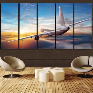 Airliner Jet Cruising over Clouds Canvas Prints (5 Pieces)