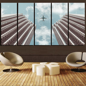 Airplane Flying over Big Buildings PrintedCanvas Prints (5 Pieces) Aviation Shop