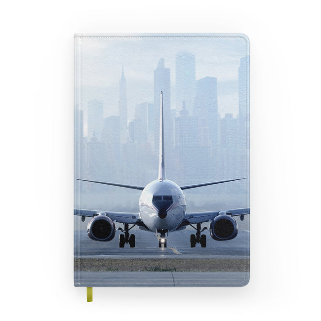 Boeing 737 & City View Behind Designed Notebooks