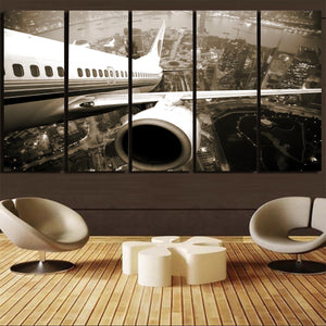 Departing Aircraft & City Scene behind Printed Canvas Prints (5 Pieces)