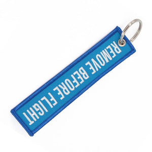 Sky Blue Remove Before Flight Designed Key Chains