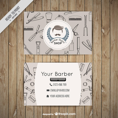 Barber shop business card with outlined tools