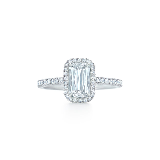 Ashoka cut diamond ring with pave diamond halo set in platinum