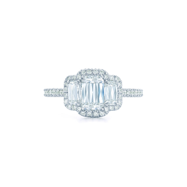 Ashoka cut 3 stone diamond ring with pave diamond halo set in platinum