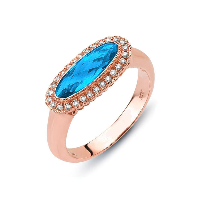 Blue topaz and diamond ring in 14kt rose gold