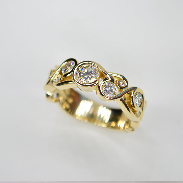 Custom designed gold wedding band with diamonds