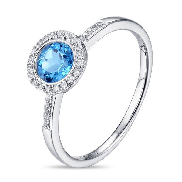 Blue topaz and diamond halo ring in 14kt white gold