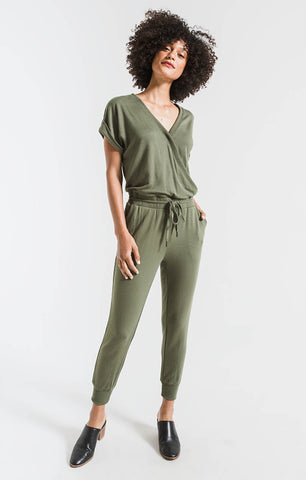 Wrap front jumpsuit in leaf clover