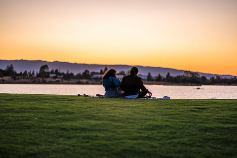 Two people watching the sunset at the park | The Smile Blog | TheWhiteningStore.com