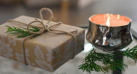 A wrapped gift and a candle | The Smile Blog | TheWhiteningStore.com