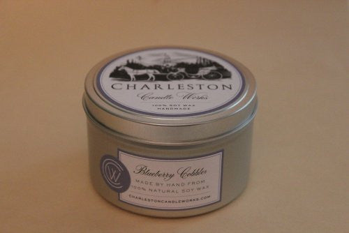 Soy candle tin that smells like blueberry cobbler.