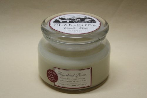 8oz candle that smells like a ginger bread house, handmade with natural soy wax.