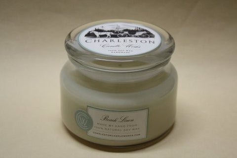8oz beach linen soy candle that smells like spring.