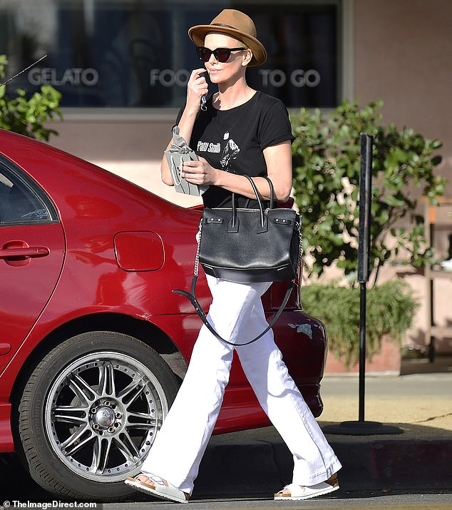 charlize theron white jeans