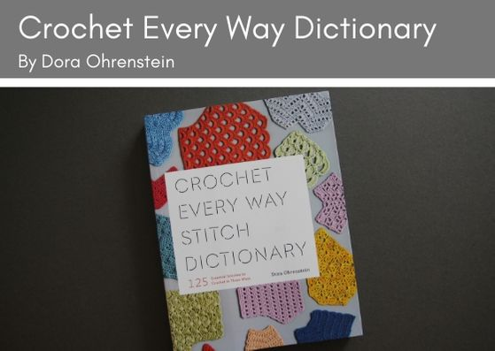 Crochet Every Way Stitch Dictionary by Dora Ohrenstein lies on a grey background.  The front cover has the title on a white rectangle and multi-coloured swatches of crochet underneath.