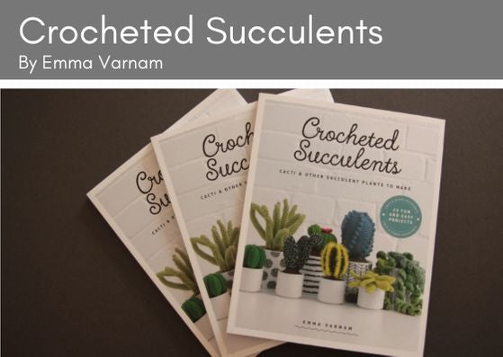 Three copis of the Crocheted Succulents book lie on top of each other on a grey background.  The book is by Emma Varnam and the cover has a white v=brick wall background with lots of potted crocheted cacti and succulents in various colours og green.