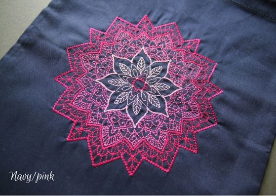 Navy mandala project bag: a close up of a navy cotton bag with a pink mandala fading from a dark outside to lighter inner.