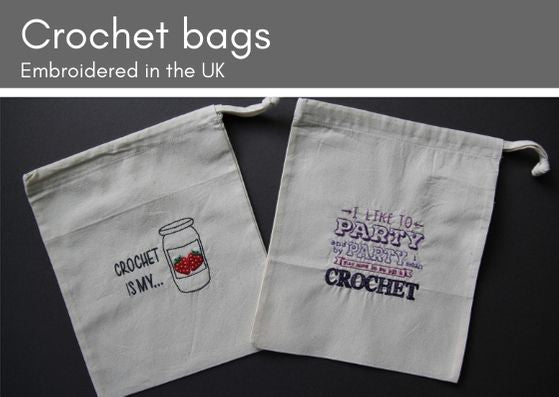 "Grey background with two natural cotton drawstring bags.  The one on the left has the words ""Crochet is my..."" and a pot of strawberry jam embroidered.  The one on the right says ""I like to party and by party I mean stay home in my pjs & knit"" embroidered in various colours of purple."
