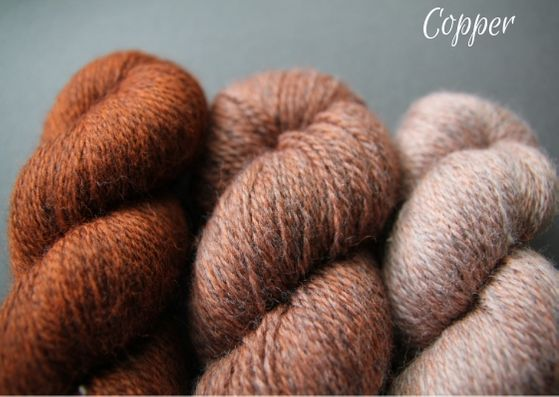 Skeins showing three shades of copper John Arbon Textiles merino 4 ply wool available getting darker from right to left.
