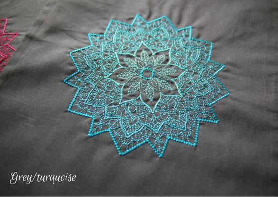 Grey mandala project bag: a close up of a grey cotton bag with a turquoise mandala fading from a dark outside to lighter inner.