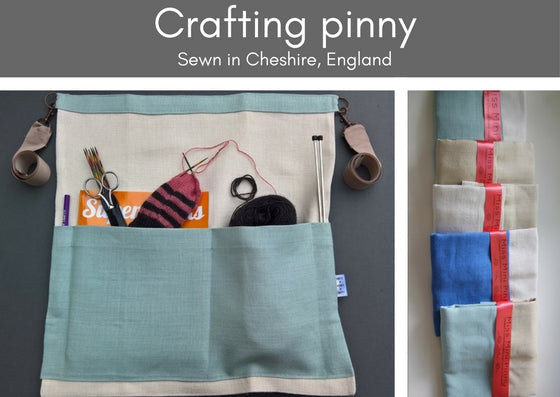 Left photo shows a linen crafting pinny in an aqua blue and bleached/bone linen.  The pockets are full of a knitting book, partially knitted sock, needles, scissors.  At eth sied of the pinny are clips with natural coloured ribbons to tie it around your waist.  The photo to the right shows the selection of colours available through a range of pinnies piled on top of each other.