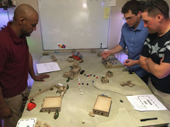 Covert Intervention Games team at work testing games