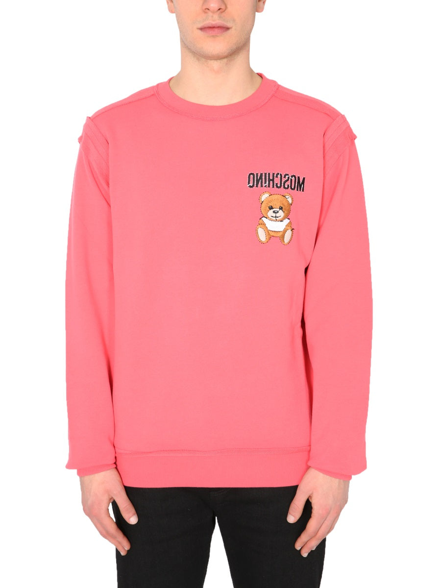 Moschino MOSCHINO INSIDE OUT TEDDY SWEATSHIRT
