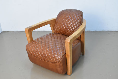 Chair in leather and hardwood arm frame