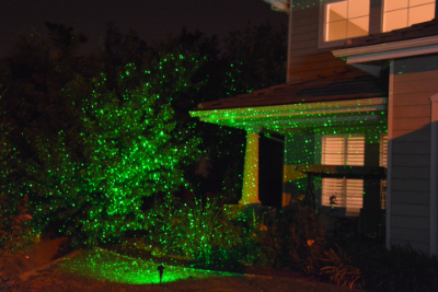 green laser projector on outdoor landscape