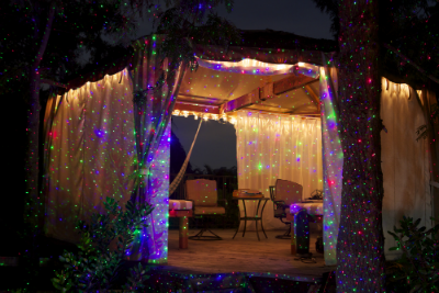 a single blisslights spright laser projector or sparkle magic illuminator can transform any landscape with firefly like laser beams - Firefly Christmas Lights