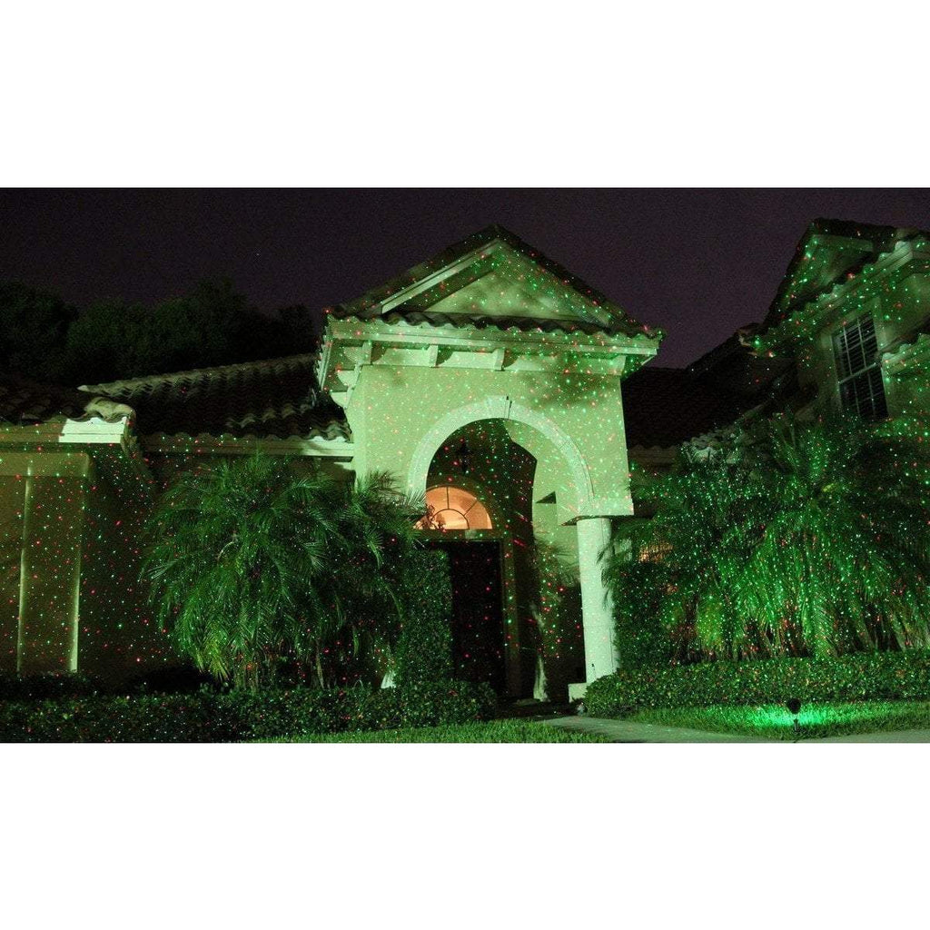 Outdoor green laser light show on house