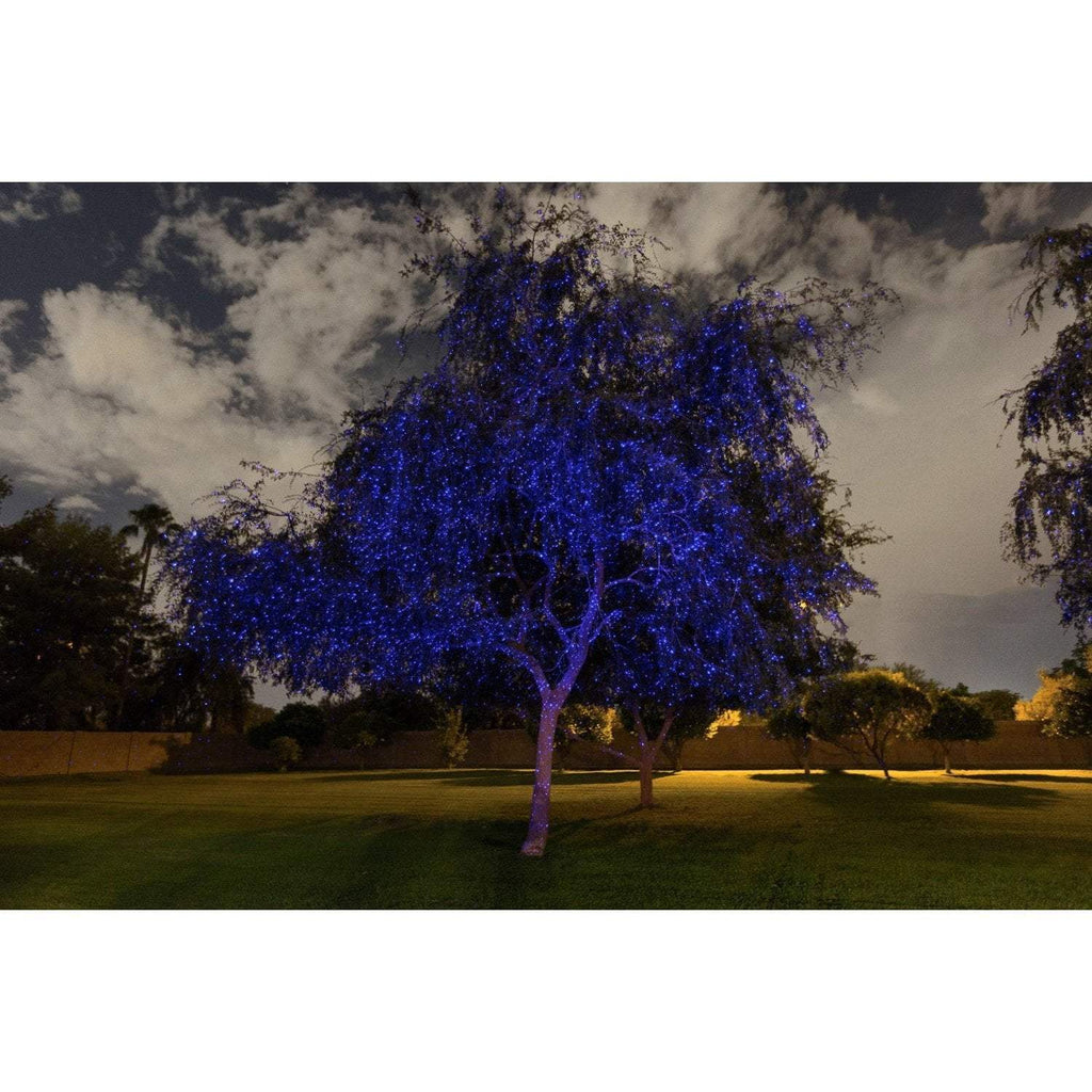 Sparkle magic illuminator blue light show display on tree